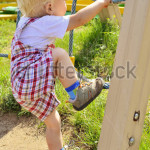 stock-photo-a-little-boy-learns-to-climb-the-ladder-on-the-playground-476248261