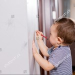 stock-photo-baby-drawing-on-wall-343145543
